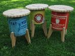collection of side tables made from vintage pretzel tins