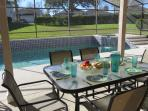 Shady lanai for relaxing under and alfresco dining