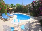 Private swimming pool in mature garden
