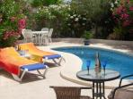 Enjoy a glass of wine or cava by the pool