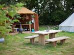 Camp kitchen and picnic bench