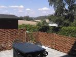 View over the patio of Stable Annexe