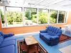 Gower Edge Conservatory overlooks the garden and is accessed through patio doors in the back lounge.
