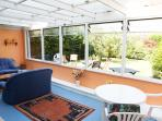 Large conservatory with washing machine and dryer, soft seating and secure bike storage