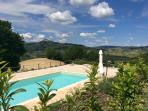Villa Miramonti swimming pool with panoramic views over hills, woods and mountains