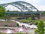 Confluence Park - flurry of activity including kayakers, beaches, lawn areas for picnic and REI