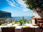 main terrace with dining table and chairs with stunning view on Seiano bay