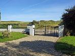 Entrance to property, the sea is just at the end of the field
