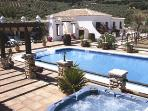 The main 80 sq m pool and heate4d jacuzzi