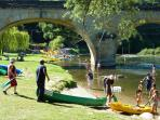 Swimming and canoeing in the village in the Dordogne.