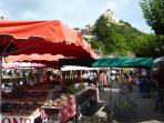 Castelnaud summer market with castle in the background