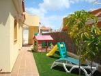 children's play area at the side of the villa