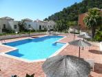 Community Pool Area, 26 metres by 18 metres,  Pool 18 metres m by 9 metres.