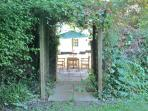 Looking through arch towards house