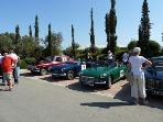 Historic car rally in village square