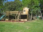 The kids play area has  sand pit, wobbly bar, rope bridge and play house