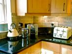 Kitchen with all new worktop appliances including Nespresso Machine and milk frother