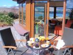 Enjoy breakfast on the south-facing patio in glorious sunshine