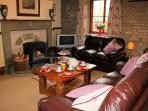 The main sitting room, view 2, with cosy woodburner