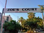 Look for the Zoe's Court sign above drive-way.  Reception office just to the left.