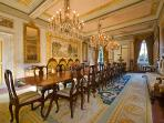 The dining room by day - crystal chandeliers, frescoes walls & great room for celebrating