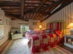 Zano is superior suite with traditional Tuscan wooden beam ceiling and views of the rolling hills