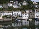 Reflections in Polperro Harbours clear water