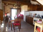 Fully equipped kitchen is just beside outdoor terrace.