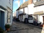 Enjoy a stroll on the cobbled streets through to the main High Street...