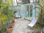 the quinquerlet garden in front of the pool with deck chairs