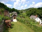 Mill Barn is approached through its private garden complete with table, chairs, storage and BBQ