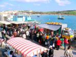 Every sunday at Marsaxlokk, Malta there is a colourful market . 10 minutes drive away from Marsascal