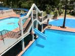 Pool area features water slides for adults and children