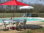 Solar heated pool with plenty of relaxing space overlooking the fields