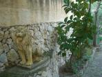 LION GUARDING THE ENTRANCE AND DRIVE