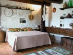 Apartment La Mangiatoia: large studio bedroom (extra bed available), kitchnet, bathroom, garden