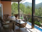 Relax on the main balcony overlooking the pool ...