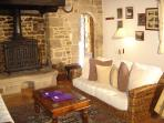 Lounge with open fire - we supply our guests with firewood free of charge