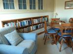 Dining area with extensive library of books, CDs and games