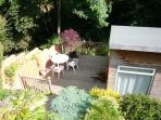 View from back deck into lower garden and stream