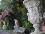 Roman amphoras and vases in the garden in front of the pool
