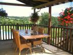 Sunny balcony with seating for great views, perfect for relaxing and al fresco dining