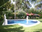 quiet pool area surrounded by private mediterranean plants and lawn