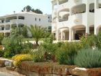 Apartment Frontage with dedicated parking located on a no through road, alongside the golf course