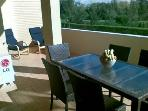 Outside Dining And Patio overlooking the Pool. All day Sun!