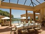 Dine overlooking the swimming pool
