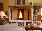 The cosy sitting room of la Maison de Marc, holiday home in La Chartreuse du Maine