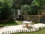 Lovely mediterranean garden patio with BBQ