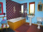 Funky big family bathroom with bath and shower over. Pamper yourself!