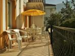 Enjoy breakfast in the morning sun on your own spacious private balcony